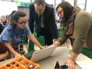 Student showing work on Laptop with Secretary Dan French